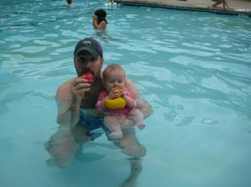 Jackie and Dad tasting pool toys